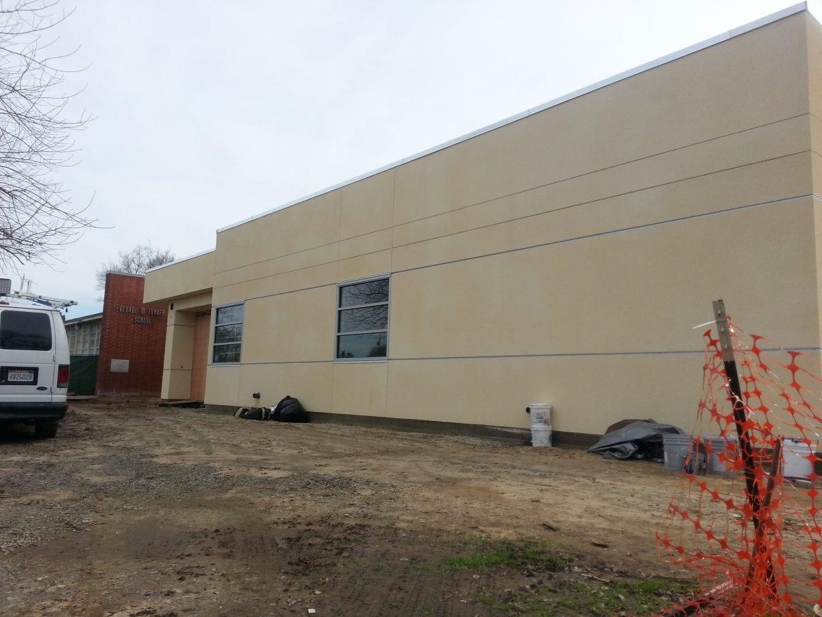 Rear view of outside of building 1/17