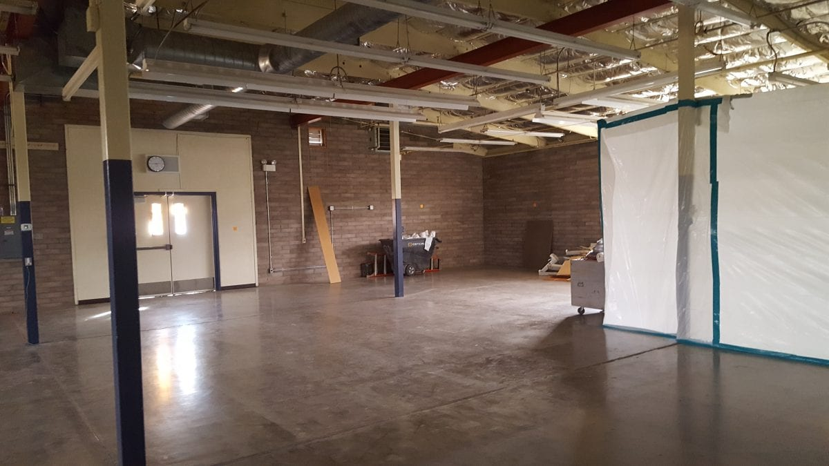 Alternative view of larger empty room with a double door