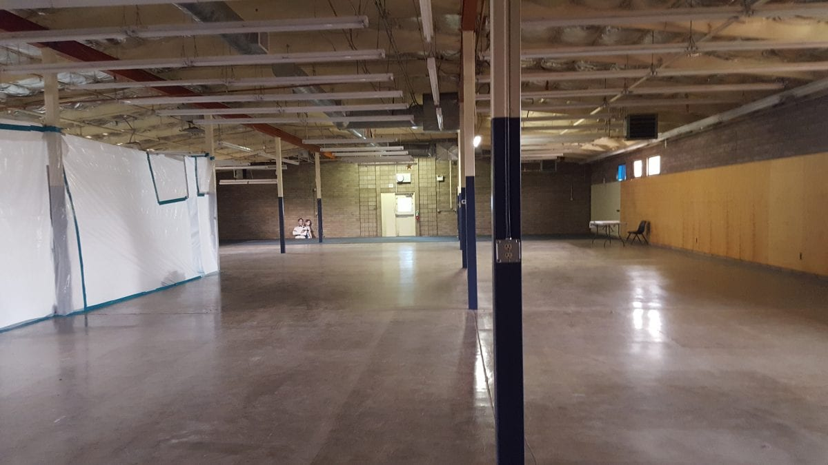 Wide view of larger room under construction