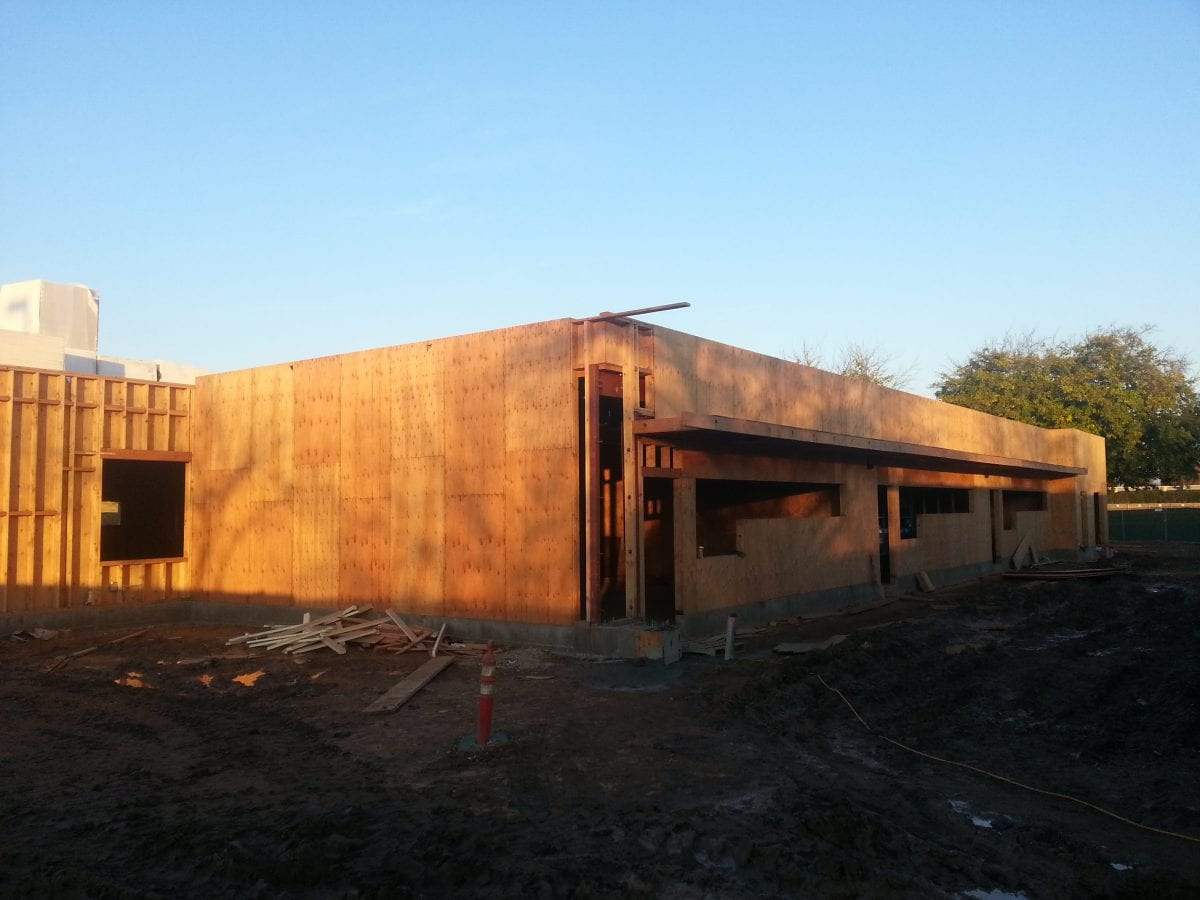 Wooden foundation of building partially shaded 12/16