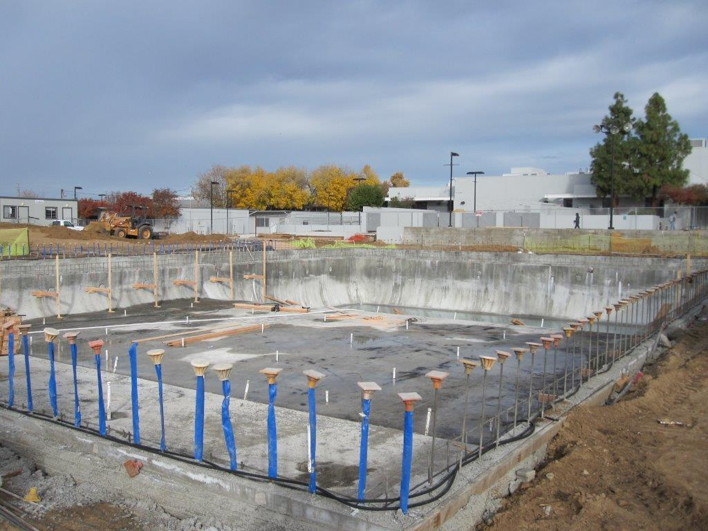Wide view of pool under construction 12/14