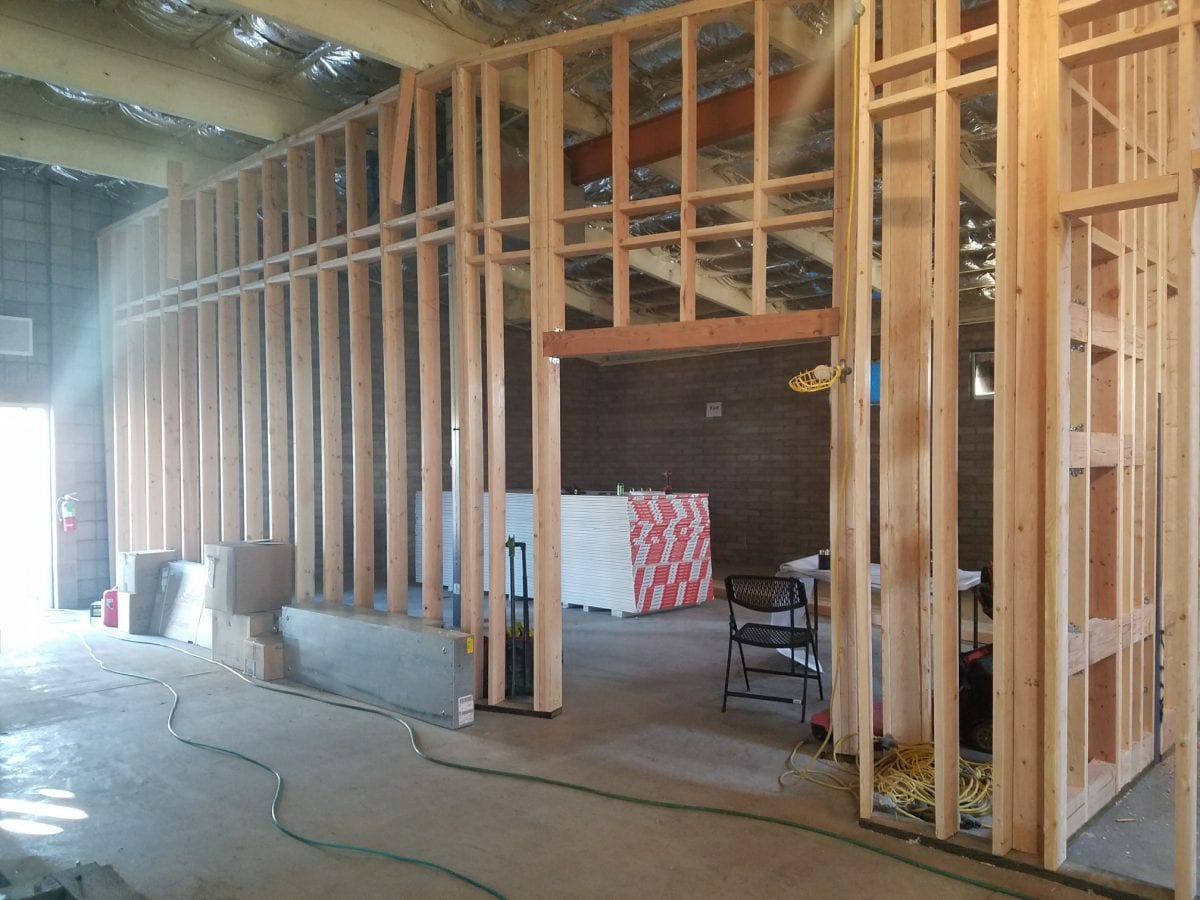 Small office construction with wooden wall supports in place