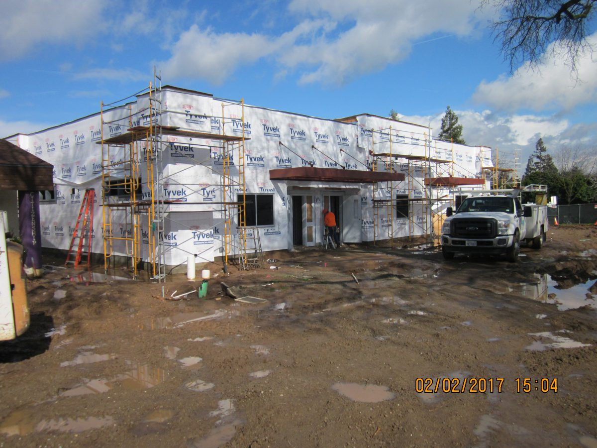 Front view of construction wrapped building 2/17