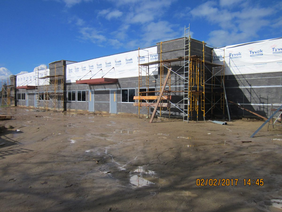 Building surrounded in commercial wrap 2/17
