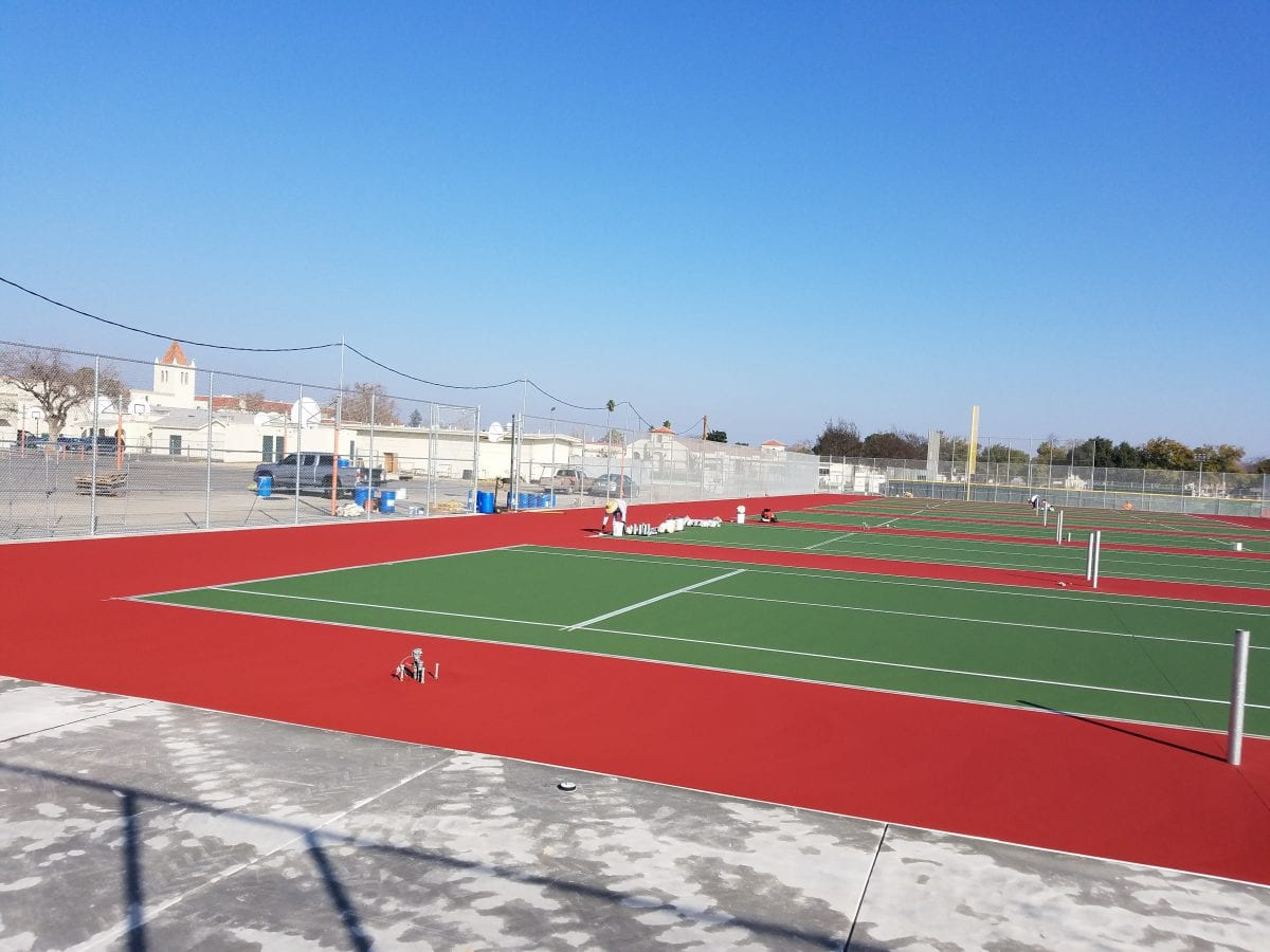 Freshly painted tennis court 2/18