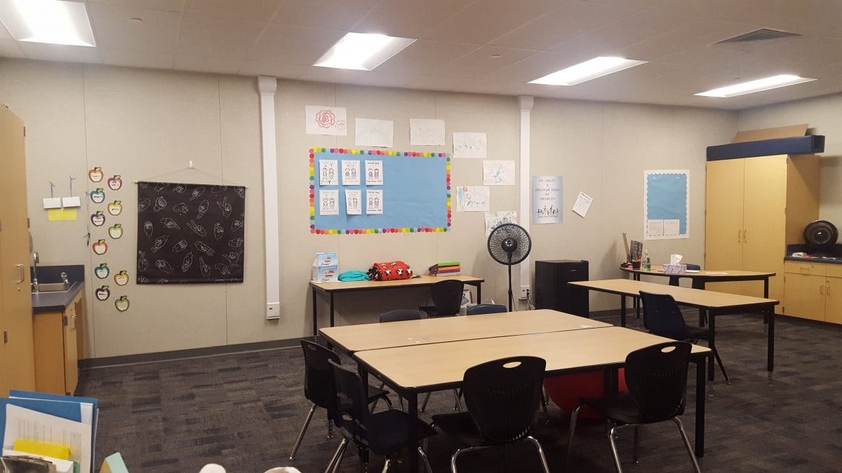 Rear view of a classroom with displays and student drawings