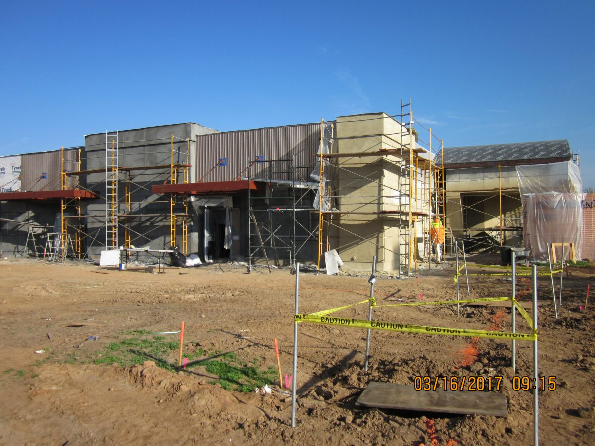 Side view of building with construction equipment around it 3/17