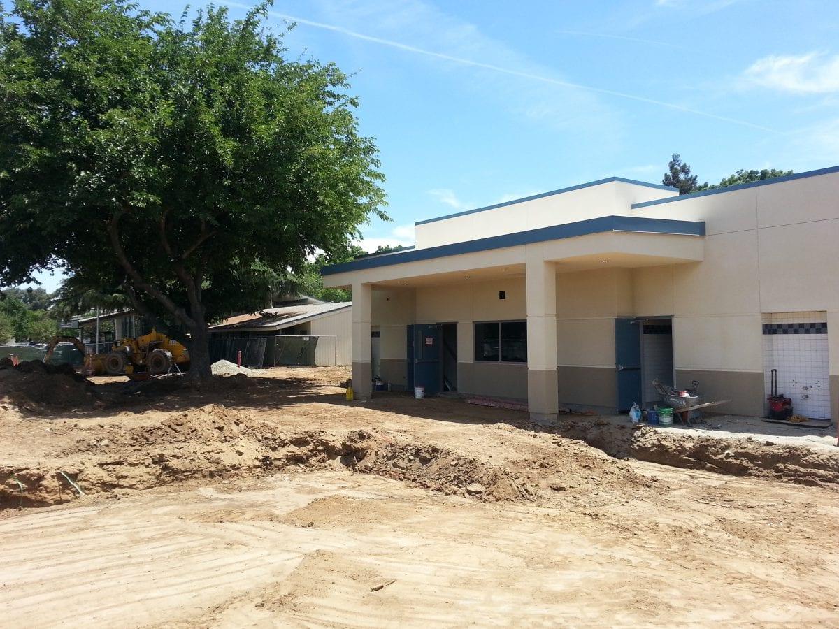 Dirt area outside buildings' restroom 6/16