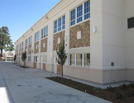 Corner view of building 8/13