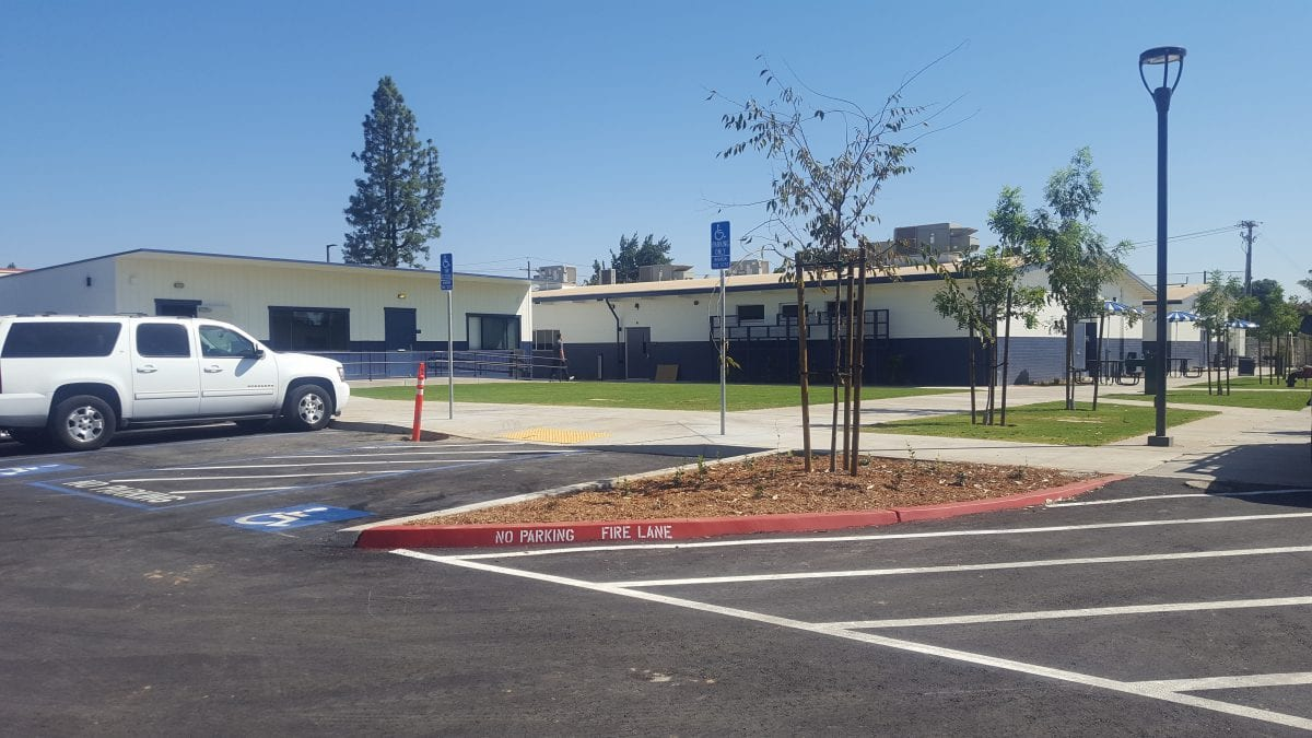 Outside view of handicapped parking and classrooms