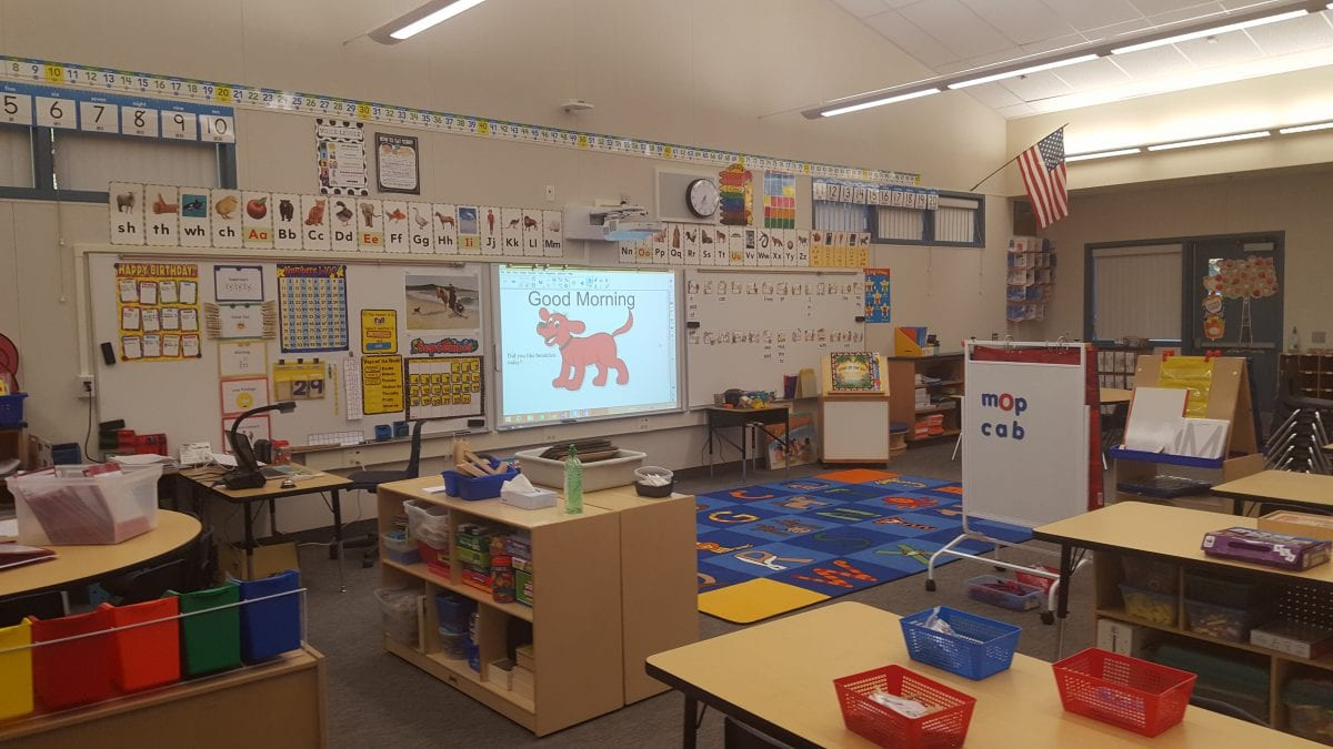 """Inside a classroom with a screen displaying """"Good Morning"""""""