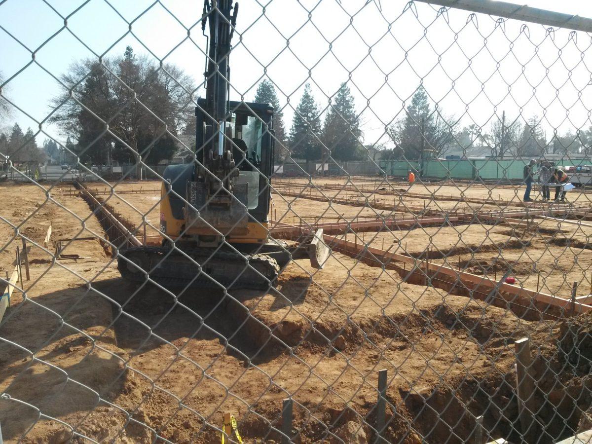 Construction Vehicle doing groundwork 2/19
